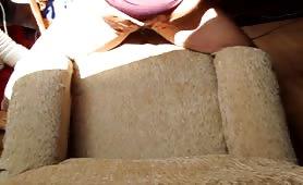 Sexy girl peeing in a sofa