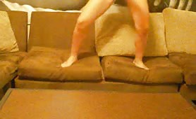 Shaking her ass while peeing on a sofa