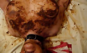 Mature woman rubbing shit on her entire body