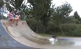 Two girls peeing in a skate park