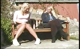 Blonde girl peeing while talking with her friend