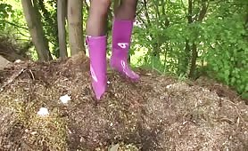 Wearing pink latex while peeing outdoor