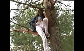 18 year old girl peeing from a tree