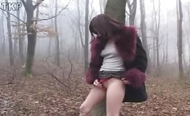 Hot milf peeing in a forest