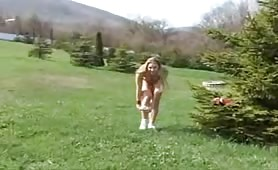Blonde college girl peeing outdoor