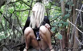 Pretty blonde caught peeing in a forest