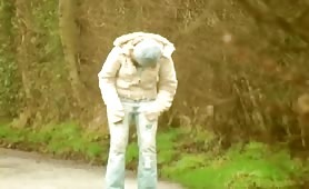 Hot girl peeing in blue jeans