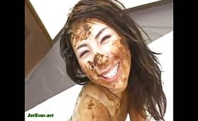 Japanese girl smears shit on her face