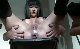 Dark haired milf shitting on black chair