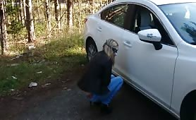 Blonde babe pooping near her car