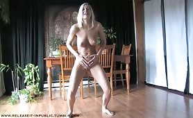 Muscular blonde peeing on floor